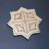 A Syrian Glazed Pottery Star Tile