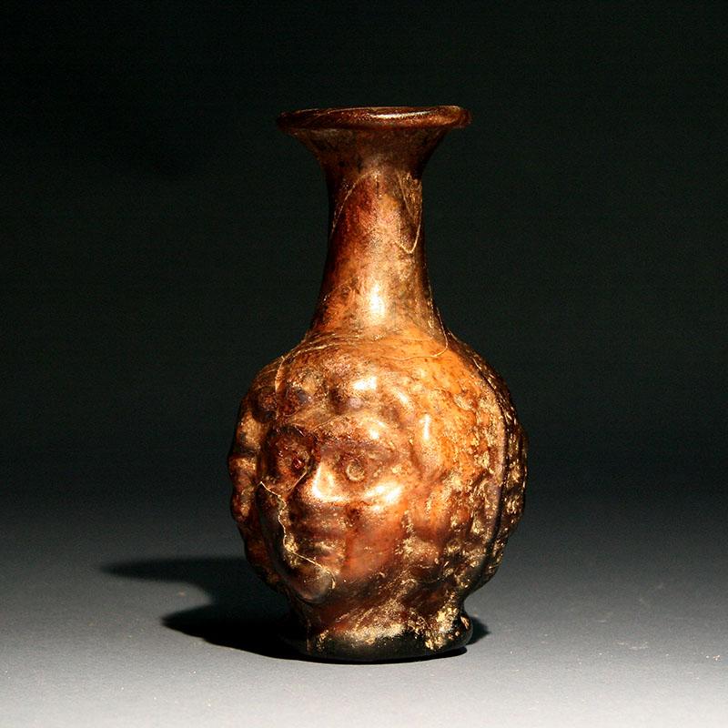 A Roman Janus Mould Blown Head Flask