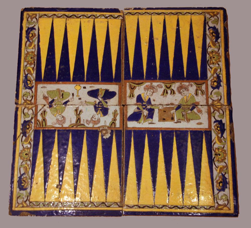 A Four Piece Tile Panel Comprising a Backgammon Board, Iran Late Safavid Period.